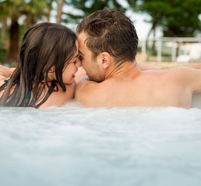 Father and daughter enjoying hot tub - Our Spas section | Pool and Spa Superstore Inc.